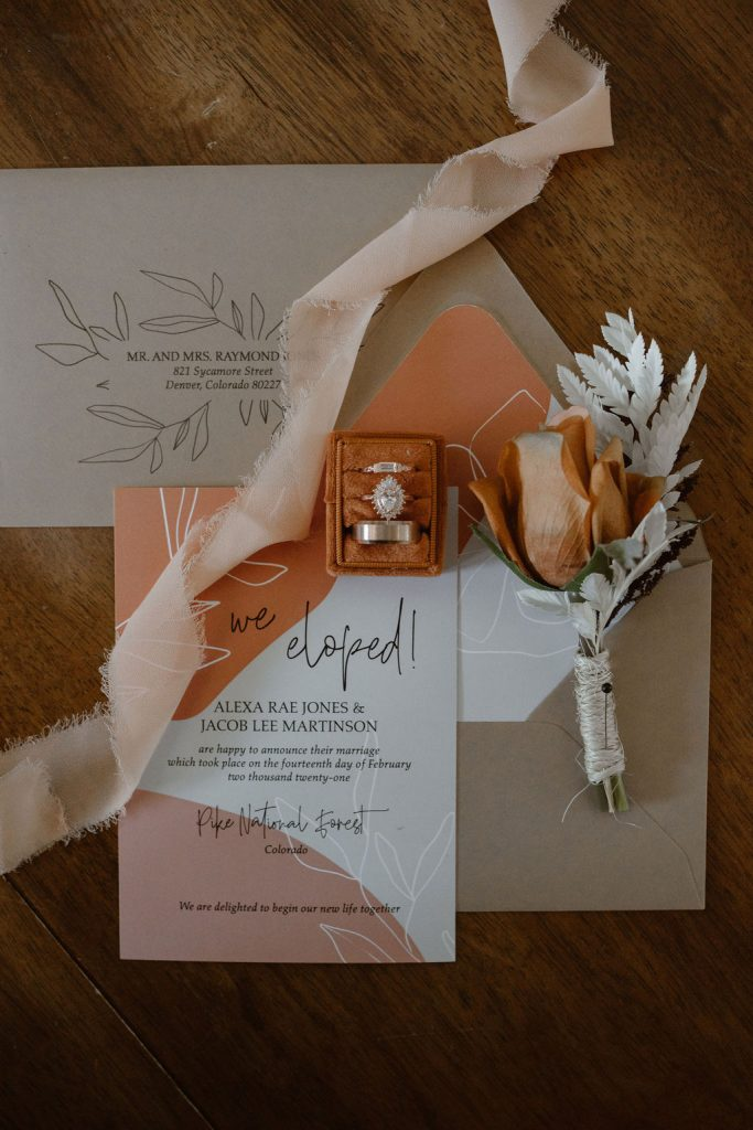 orange, blue, and pink wedding stationery of a colorado winter elopement announcement