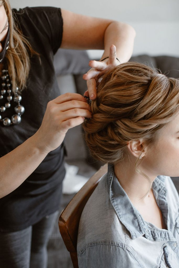 rollers and rouge professionally doing the hair of a bride