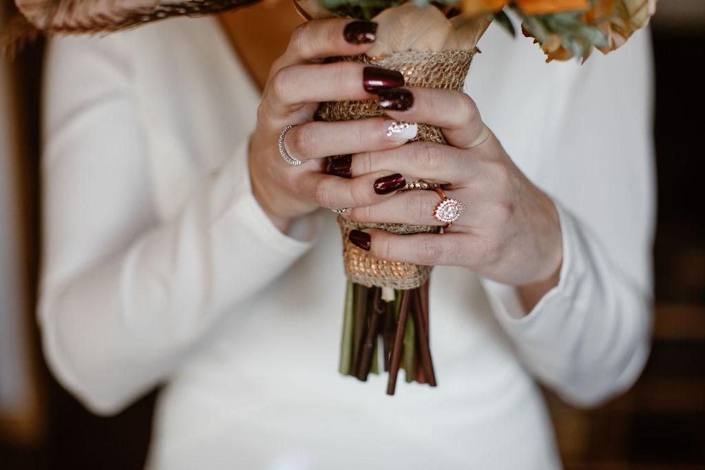 a women holding a floral bouquet
