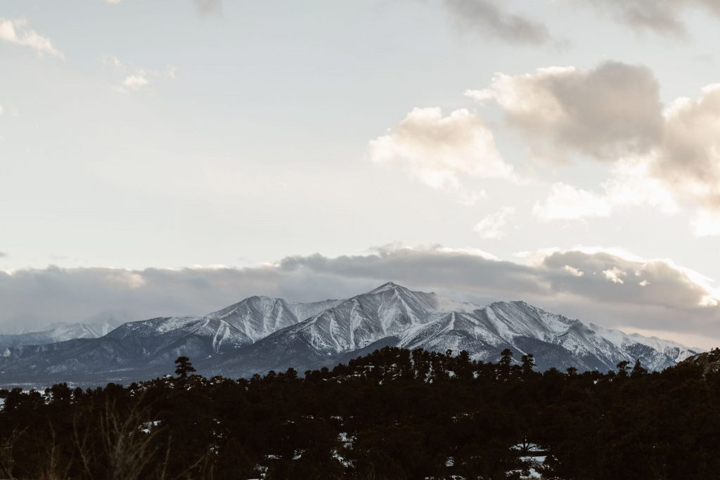 a photo at sunset of the collegiate peaks in colorado