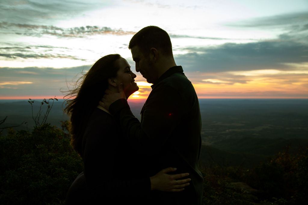 a beautiful sunrise with a couples silhouette