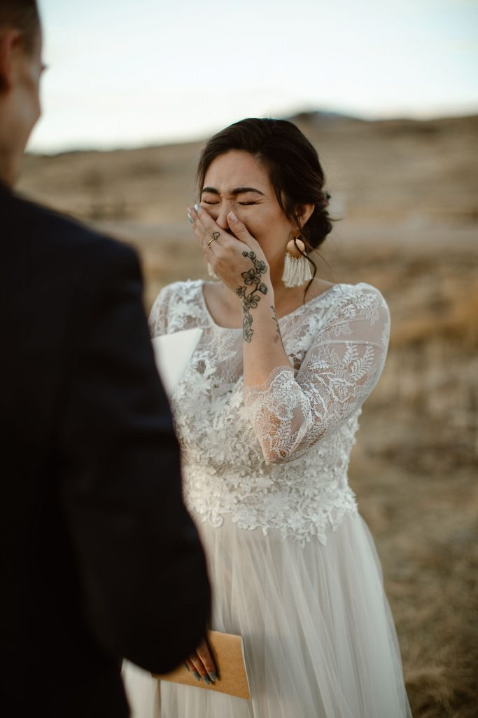 a close up of a bride crying during her elopement ceremony