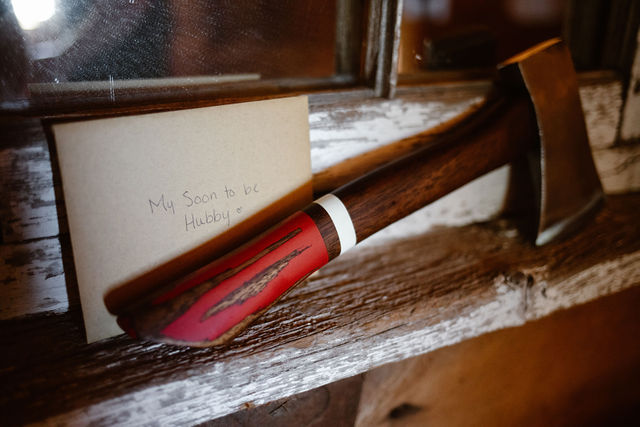 a card and an axe sitting on a wooden ledge