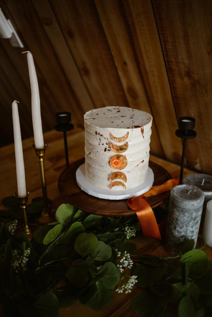 a white celestial themed wedding cake